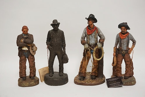 LOT OF 4 MICHAEL GARMAN COWBOY SCULPTURES. CERAMIC. TALLEST IS 10 3/8 INCHES. SO