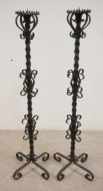PAIR OF WROUGHT IRON PRICKETT STICKS MEASURING 44 INCHES HIGH.