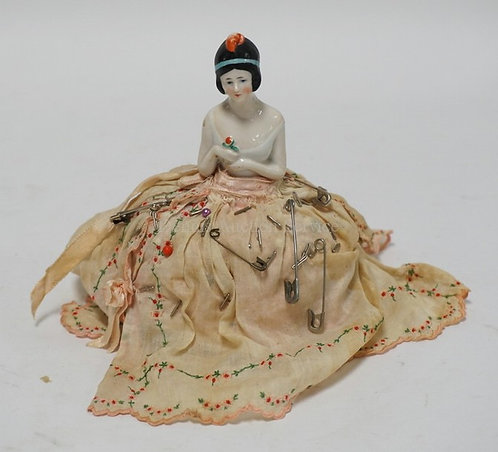 PORCELAIN PIN CUSHION DOLL MEASURING 5 INCHES HIGH.