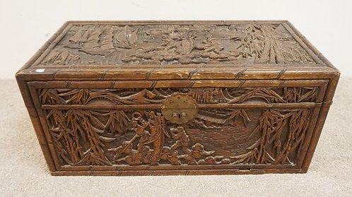 CARVED ASIAN BOX. 35 X 17 1/2 X 16 INCHES HIGH. DEEP RELIEF SCENIC CARVINGS.