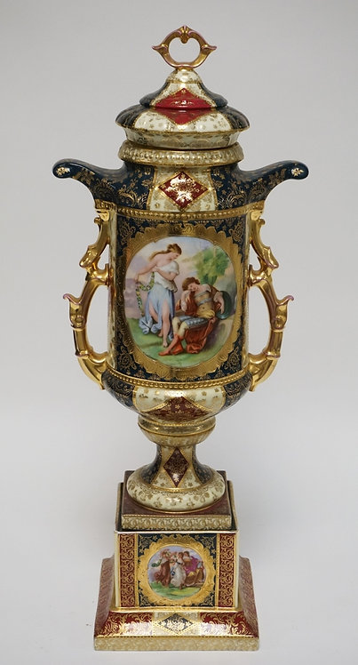 LARGE AUSTRIAN PORCELAIN BOLTED URN W/LID. SCENIC VIGNETTES OF FIGURES IN THE CO