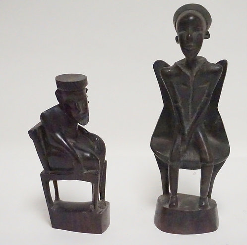 GROUP OF 2 HAND CARVED ETHNIC FIGURES. TALLEST IS 10 1/2 INCHES.