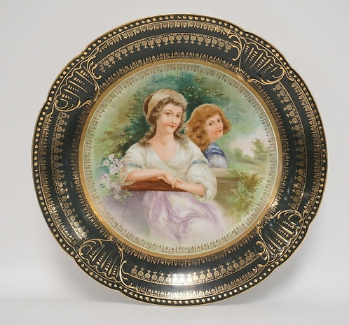 TRANSFER DECORATED WALL PLATE WITH AN IMAGE OF TWO WOMEN SURROUNDED BY FLOWERS A