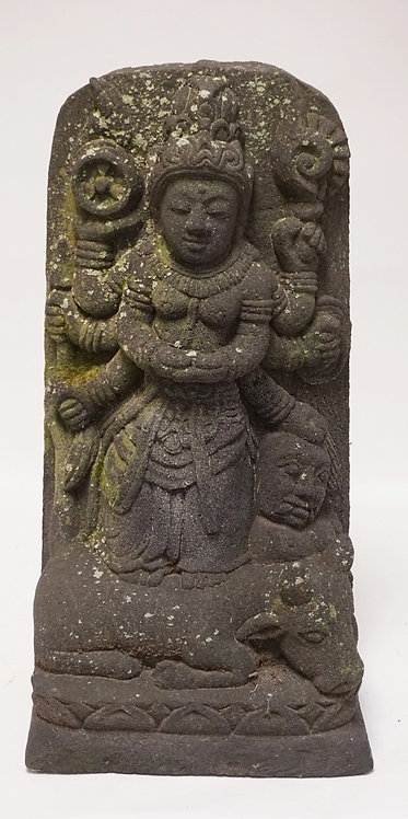 STONE SCULPTURE OF AN ASIAN DIETY ON AN ANIMAL. 24 INCHES HIGH.
