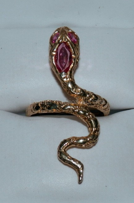 14K YELLOW GOLD SNAKE FORM RING WITH 3 INSET RUBIES. APPROX SIZE 6 1/2.