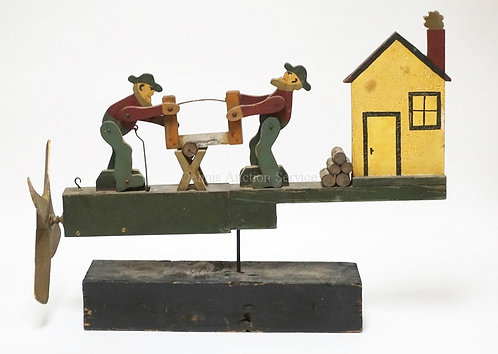 WOODEN WHIRLY GIG. 2 MEN SAWING WOOD W/ HOUSE AND WOODPILE. ONE BLADE CHIPPED. 2