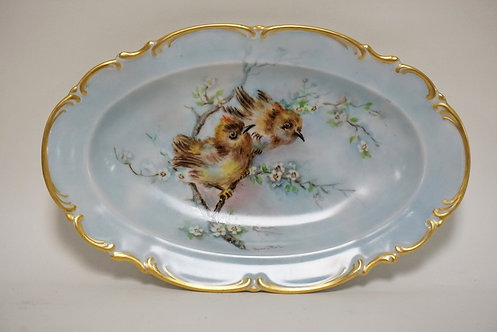 HUTSCHENREUTHER HAND PAINTED OVAL DISH DECORATED WITH BIRDS. SIGNED *HENRIETTE L