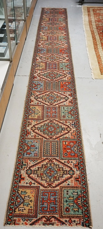 ORIENTAL RUNNER MEASURING 14 FT 11 INCHES X 1 FT 10 INCHES.