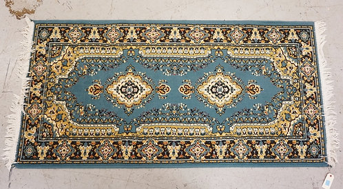 ORIENTAL AREA RUG MEASURING 6 FT 4 INCHES X 3 FT 2 INCHES.