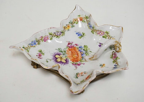 NICHOLAS HAYDON HAND PAINTED PORCELAIN LEAF FORM DISH WITH A GILT METAL FOOTED F