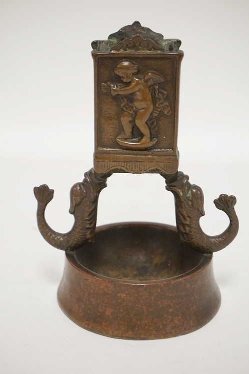 BRONZE ASHTRAY & MATCH BOX HOLDER. DOLPHIN FIGURED SUPPORTS AND RELIEF DECORATIO