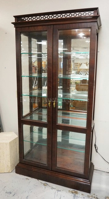 CURIO CABINET WITH GLASS SHELVES, A MIRRORED BACK, AND A LIGHTED INTERIOR. 82 IN