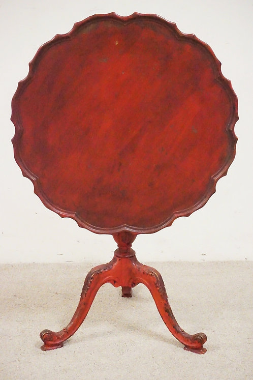 CARVED TILT TOP TABLE IN RED PAINT. 28 INCH DIA.
