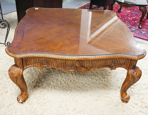 CARVED COFFEE TABLE WITH A GLASS TOP. 42 INCHES SQUARE.