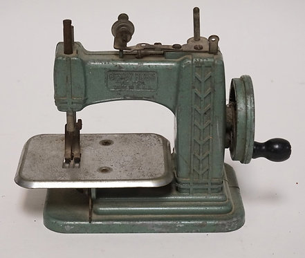 VINTAGE *BETSY ROSS* CHILDS TOY SEWING MACHINE. 8 INCHES LONG. 6 INCHES HIGH.
