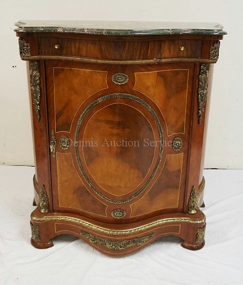 MARBLE TOP CABINET WITH A BOWED FRONT, APPLIED ORMOLU , AND VARIOUS VENEERS AND