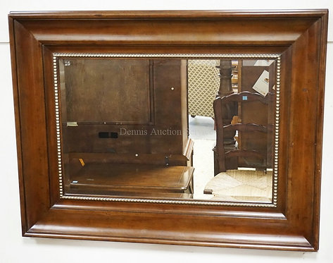 LARGE BEVELED MIRROR IN A THICK WOODEN FRAME. 39 X 51 INCHES.