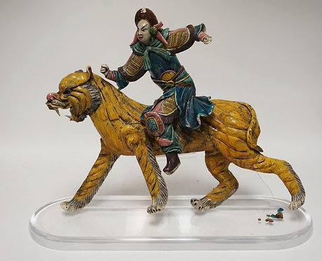 ASIAN POTTERY TIGER & RIDER MOUNTED TO A LUCITE BASE. SOME LOSSES. 21 INCHES HIG