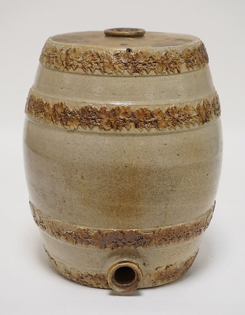 STONEWARE WATER COOLER WITH EMBOSSED RINGS OF GRAPE AND VINE DECORATIONS. 12 1/2