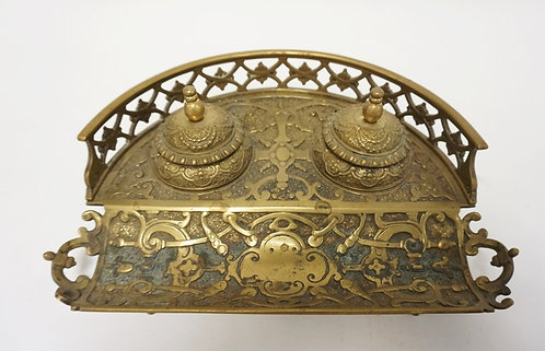 ORNATE VICTORIAN BRASS DOUBLE INKWELL. ONE GLASS INSERT MISSING. 10 1/2 IN WIDE