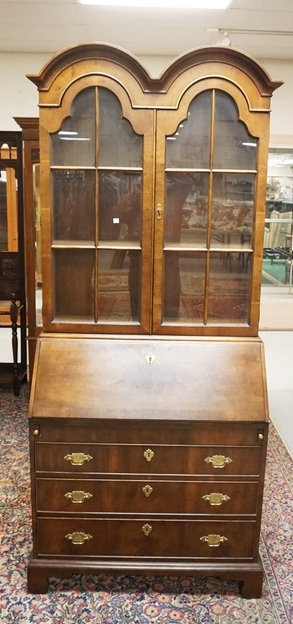 HENREDON WALNUT SECRETARY DESK WITH A DOUBKE ARCH TOP. 81 INCHES HIGH. 34 1/2 IN