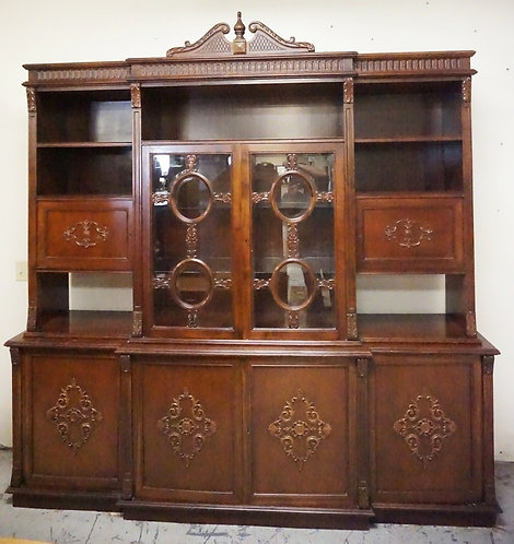 LARGE 2 PIECE CREDENZA. THE VASE HAVING 4 BLIND DORS WITH CARVED MEDALLIONS. THE