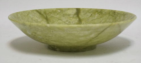 CARVED GREEN STONE BOWL MEASURING 10 3/4 INCHES IN DIA AND 2 3/4 INCHES HIGH.