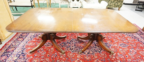 MAHOGANY DINING TABLE WITH A DOUBLE PEDESTAL BASE AND 2 LEAVES. 53 3/4 X 82 INCH