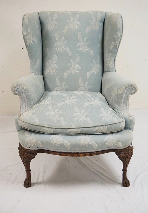 ANTIQUE WING CHAIR WITH CARVED BALL & CLAW FEET.