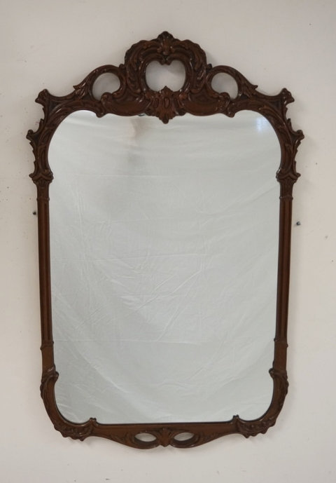 CARVED MAHOGANY MIRROR MEASURING 27 3/4 X 43 1/2 INCHES.