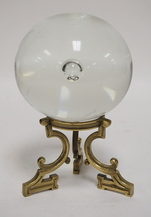 CRYSTAL BALL ON A BRASS STAND. 8 INCHES HIGH.