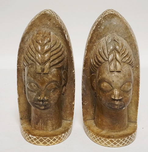 PAIR OF CARVED STONE BOOKENDS. 8 1/2 INCHES HIGH.