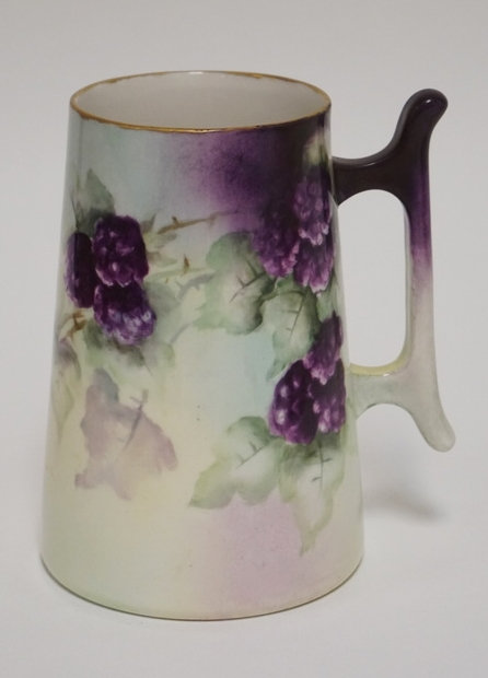 WILLETS BELEEK PORCELAIN MUG. HAND PAINTED WITH BERRIES. 5 5/8 INCHES HIGH.