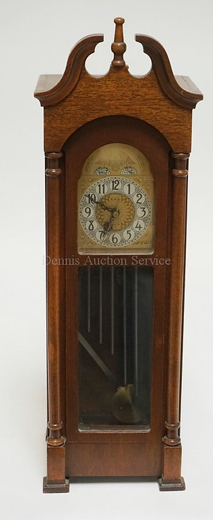 MINIATURE TALL CASE CLOCK WITH WESTMINSTER CHIMES. 19 INCHES HIGH.