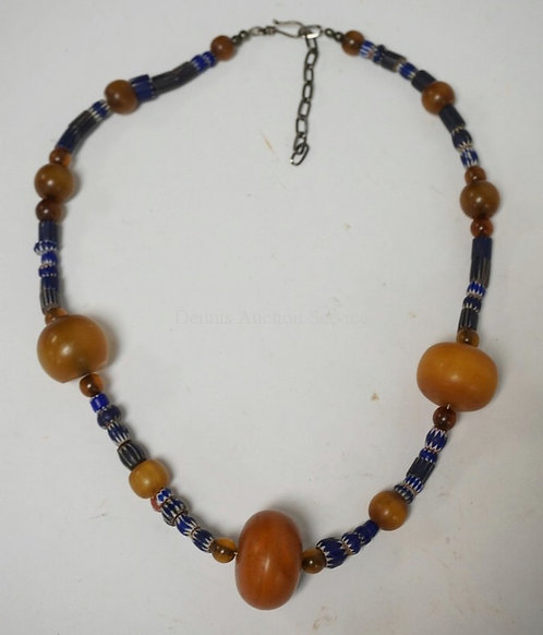 BEADED NECKLACE HAVING ANTIQUE AMBER AND CHEVRON TRADE BEADS.