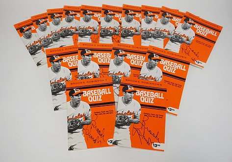 LOT OF 16 AUTOGRAPHED COPIES OF BROOKS ROBINSON'S *BASEBALL QUIZ* BOOK,