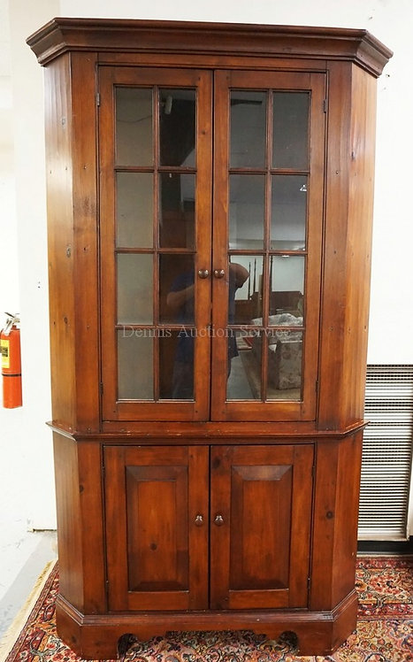 2 PIECE PINE CORNER CUPBOARD WITH 16 LIGHTS. 86 INCHES HIGH. 49 1/4 INCHES WIDE.