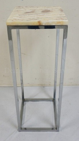 MODERN CHROME STAND WITH A MARBLE TOP. 34 INCHES HIGH. 12 INCHES SQAURE.