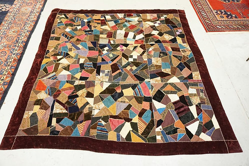 LARGE ANTIQUE CRAZY QUILT MEASURING 8 FT 6 INCHES X 8 FT 6 INCHES. SOME WEAR.