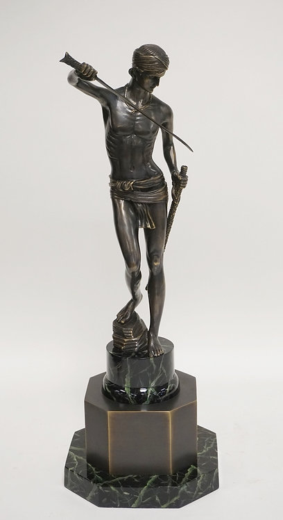 CONTEMPORARY SCULPTURE OF A MAN WITH A SWORD. FAUX MARBLE MOUNTS. 19 1/4 INCHES