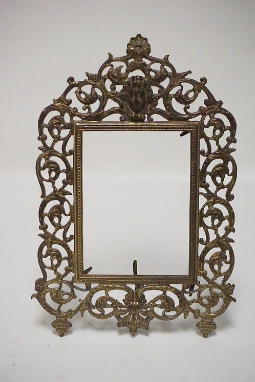 ORNATE CAST IRON PHOTO FRAME. GOLD GILT. 14 1.4 X 9 INCHES.