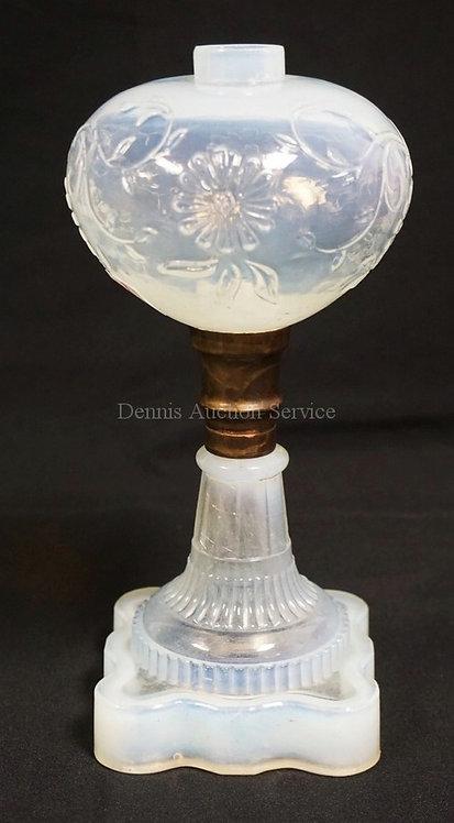 ANTIQUE OPALESCENT FLINT SANDWICH GLASS OIL LAMP WITH A FLOWER MOLDED FONT. 9 1/