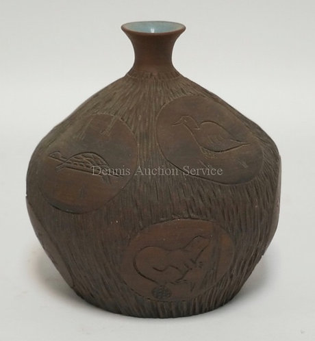 ART POTTERY VASE WITH INCISED DECORATIONS OF ANIMALS. SIGNED. 6 INCHES HIGH.