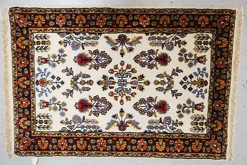 HAND WOVEN ORIENTAL RUG MEASURING 2 FT 11 X 2 FT.