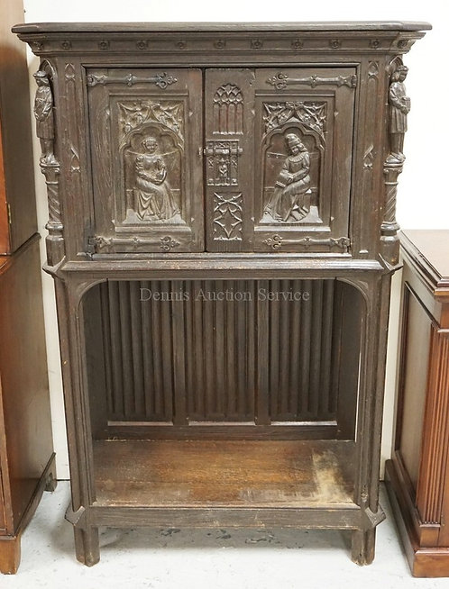 ANTIQUE CARVED OAK 2 DOOR CUPBOARD. FULL FIGURAL COLUMNS WITH DEEP RELIEF CARVED