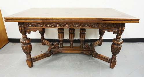 OAK REFRACTORY TABLE WITH A CARVED BASE. 58 1/2 X 38 INCH TOP. PULL OUT LEAVES M