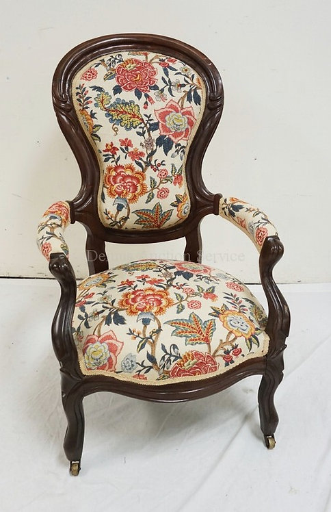 VICTORIAN CARVED WALNUT ARMCHAIR WITH COLORFUL FLORAL UPHOLSTERY. 26 INCHES WIDE