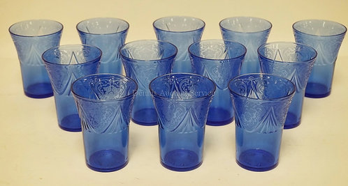 12 HAZEL ATLAS COBALT BLUE ROYAL LACE TUMBLERS MEASURING 4 1/8 INCHES HIGH.