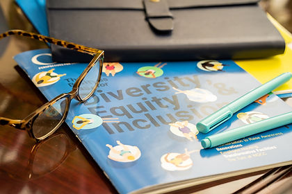 Notebooks and glasses on a table