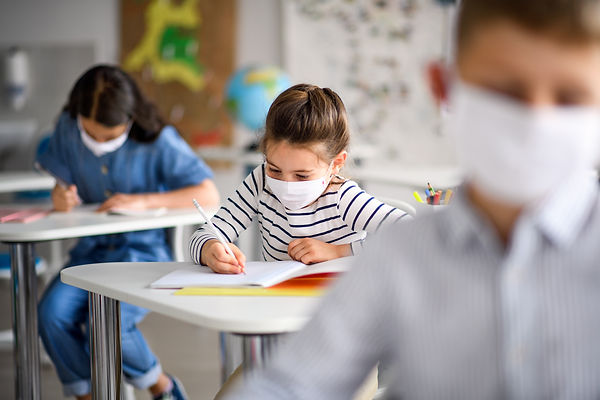 Children with face mask back at school a